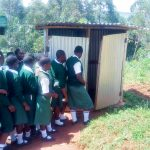 The Water Project: Kwirenyi Secondary School -  Girls Lined Up To Use The Latrines