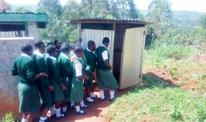 The Water Project:  Girls Lined Up To Use The Latrines