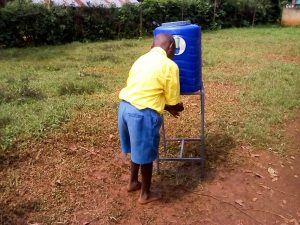 The Water Project:  Student Using New Handwashing Station