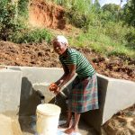 The Water Project: Luvambo Community, Timona Spring -  Flowing Water
