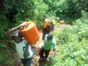 The Water Project:  Carrying Water Up The Hill From The Stream