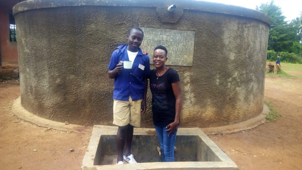 The Water Project : kenya4642-raphael-nyangweso-standing-at-the-tank