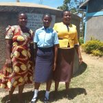 The Water Project: St. Marygoret Girls Secondary School -  Field Staff Betty Muhongo With Mary And Leah At The Tank