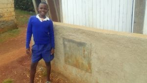 The Water Project:  One Of The Students Poses Next To The Improved Latrines