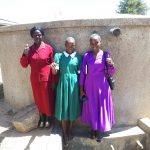 The Water Project: Kalenda Primary School -  Field Staff Joan Were With Alice And Jackyline At The Tank