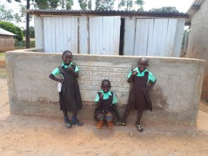 The Water Project:  Students Pose In Front Of Latrines