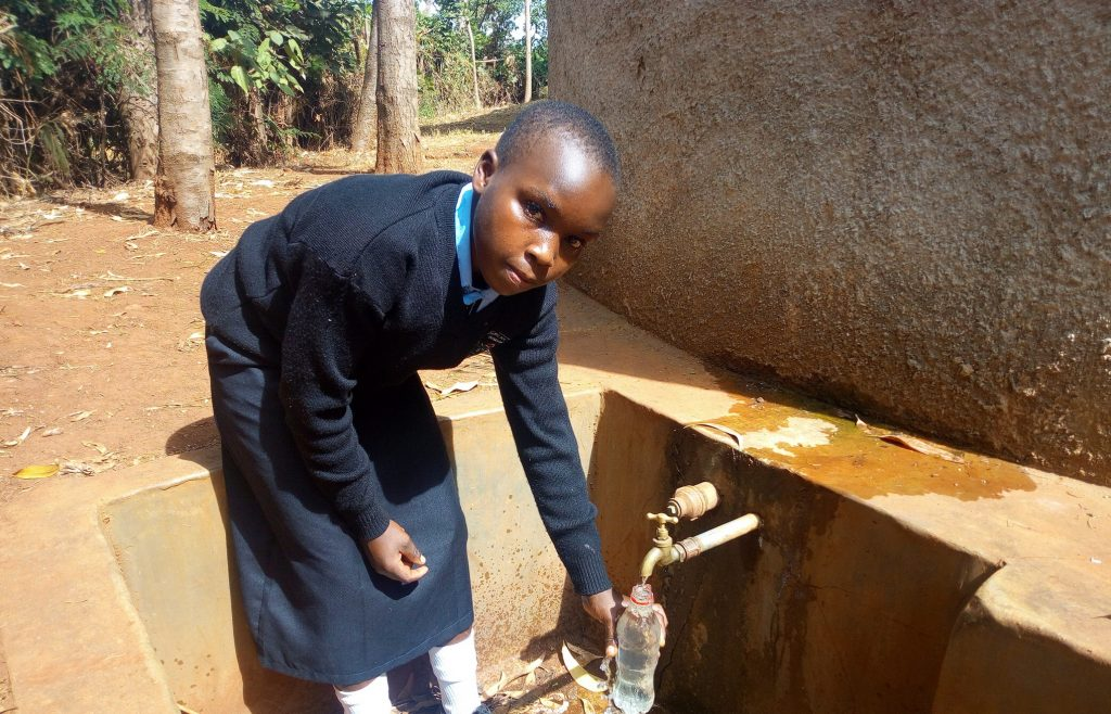 The Water Project : kenya4660-ivy-kagea-collecting-water-at-the-tank