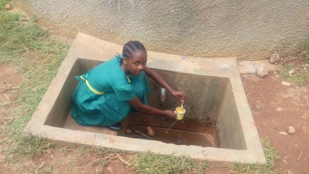 The Water Project : kenya4663-sheila-alili-collecting-water