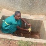 The Water Project: Mukhombe Primary School -  Sheila Alili Collecting Water