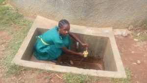 The Water Project:  Sheila Alili Collecting Water