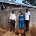 The Water Project: Ematsuli Primary School -  Posing With Zablon Kube And Winfred Mudesia At The Tank