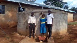 The Water Project:  Posing With Zablon Kube And Winfred Mudesia At The Tank