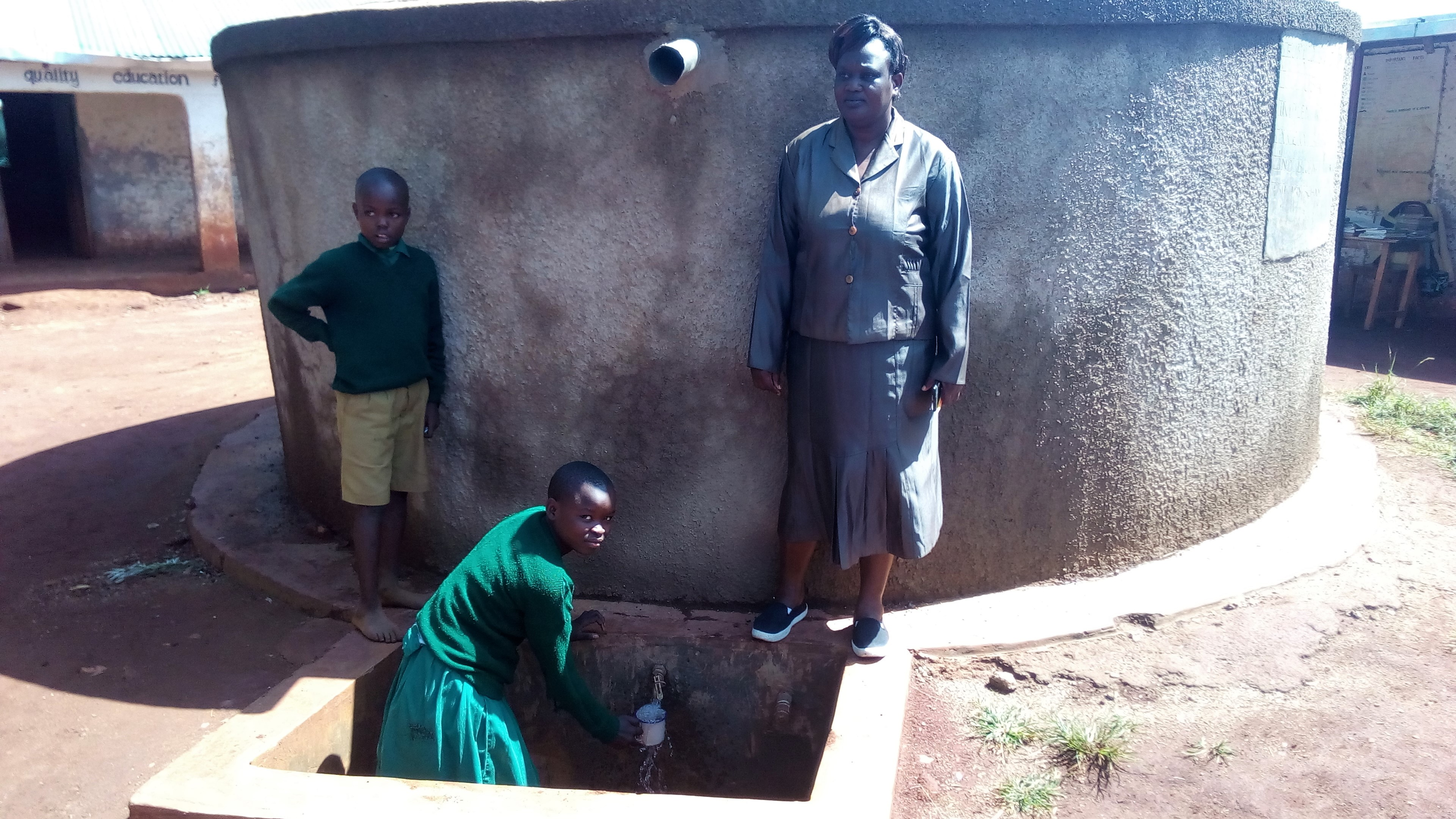 The Water Project : kenya4666-magret-afywande-fetching-water