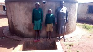 The Water Project:  Smiles In Front Of The Tank