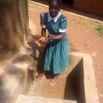The Water Project: Emurembe Primary School -  Eunice Holds Up Water