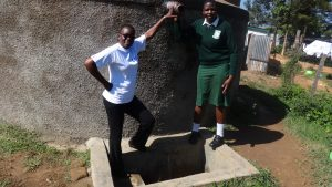 The Water Project:  Field Officer Mary Afandi And Maureen Lumula At The Tank