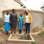 The Water Project: Musunji Primary School -  Margaret Aduvukha Prudence Mbone And Field Officer Janet Kayi