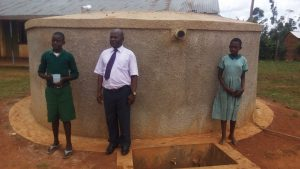 The Water Project:  Patrick Anyembe And Students In Front Of Tank