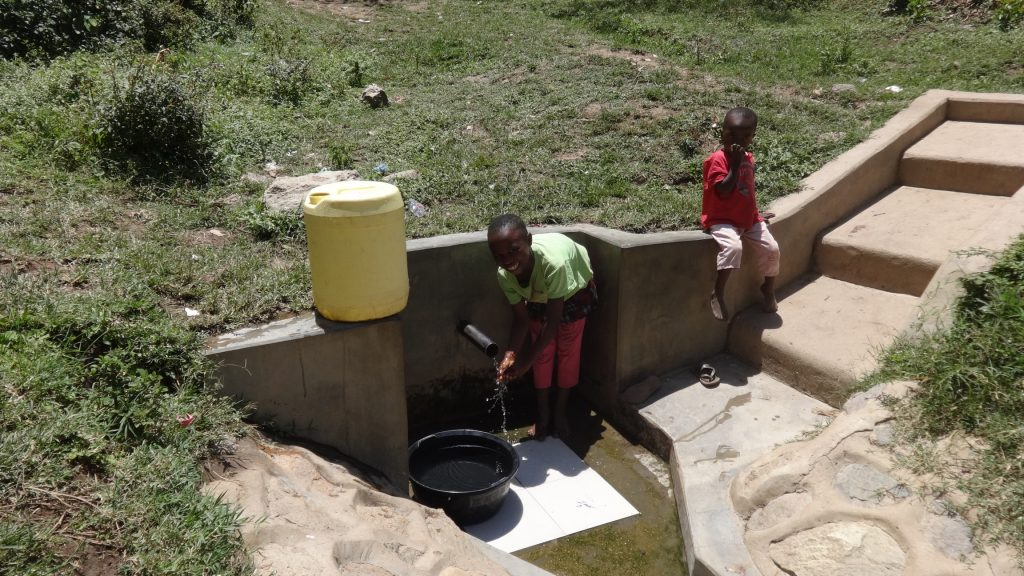 The Water Project : kenya4696-esther-waka-fetching-water