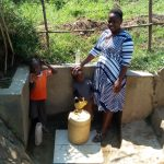 The Water Project: Emarembwa Community -  Celinia Makomere And Her Family Stand At The Spring