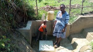 The Water Project:  Celinia Makomere And Her Son