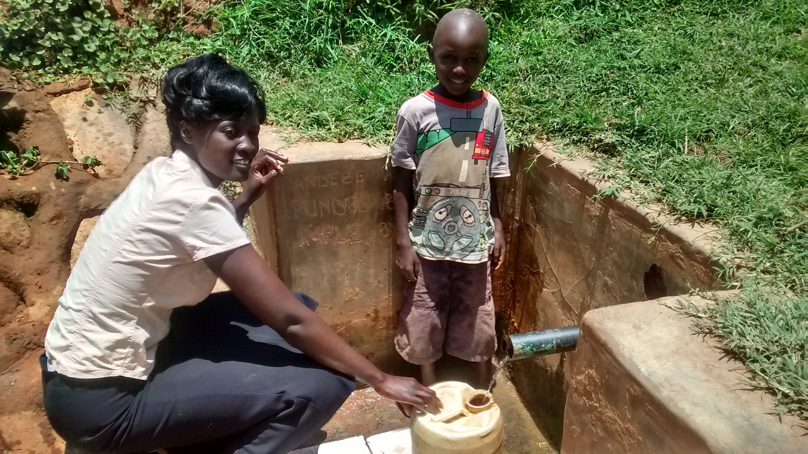 The Water Project : kenya4715-smiles-for-reliable-water