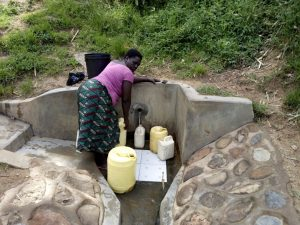 The Water Project:  Mary Khasiala Fetches Water From The Spring