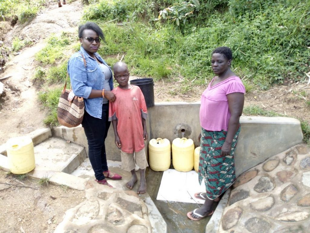 The Water Project : kenya4718-our-field-staffer-poses-with-philius-akola-and-mary-khasiala