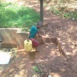 The Water Project: Wanzuma Community -  Returning Home With Safe Water