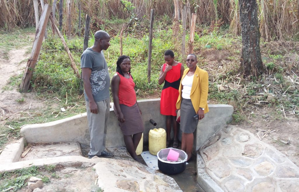 The Water Project : kenya4726-gathered-at-the-spring