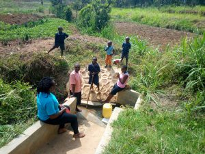 The Water Project:  Our Field Staff Conducting A Refresher Training On Spring Maintenance
