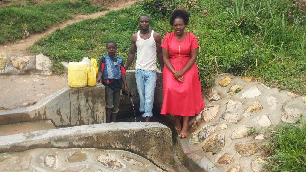 The Water Project : kenya4731-eugine-amala-enock-amala-and-field-officer-karen-maruti