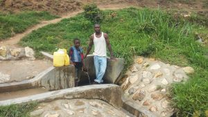 The Water Project:  Eugine Amala And Enock Amala At The Spring