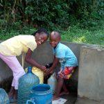 The Water Project: Shikhambi Community, Daniel Inganga Spring -  Rice Russel And Carlos