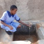 The Water Project: Chief Mutsembe Primary School -  Fetching Water
