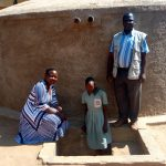 The Water Project: Eshilakwe Primary School -  Standing With Rainwater Tank