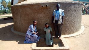 The Water Project:  Standing With Rainwater Tank