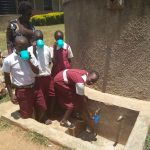 The Water Project: Bukura Primary School -  Drinking Water From The Tank