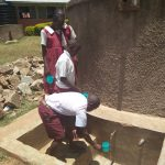 The Water Project: Bukura Primary School -  Fetching Water From The Tank