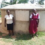 The Water Project: Bukura Primary School -  The Sanitation Teacher Mrs Violet Andayi And The Pupil Laura Madolyne
