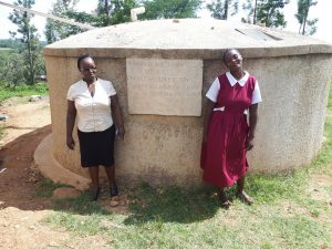 The Water Project:  The Sanitation Teacher Mrs Violet Andayi And The Pupil Laura Madolyne