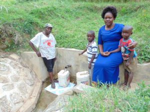 The Water Project:  Moses Enani And His Family At The Spring
