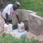 The Water Project: Bushevo Community -  Moses Enani Collecting Water