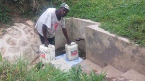 The Water Project:  Moses Enani Collecting Water