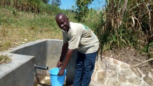 The Water Project:  Tom Shakava Collecting Water