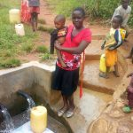 The Water Project: Timbito Community, Atechere Spring -  Community Members Enjoying Clean Water A Year Later At Atechere Spring