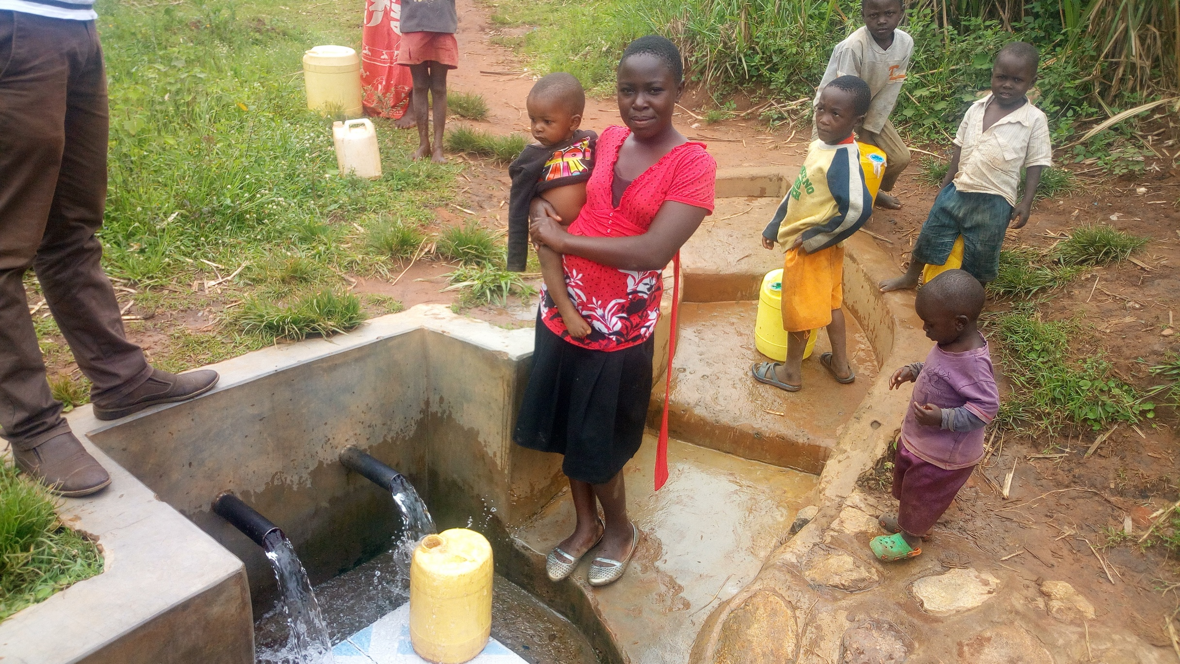 The Water Project : kenya4847-community-members-enjoying-clean-water-a-year-later-at-atechere-spring