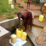 The Water Project: Timbito Community A -  Fetching Water At The Spring
