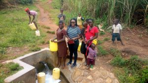 The Water Project:  Field Officer Christine Center Poses For A Picture With Community Members At The Spring