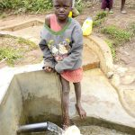 The Water Project: Timbito Community A -  Victoria Kageha Fetching Water